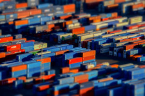 stacks of large shipping containers in storage yard